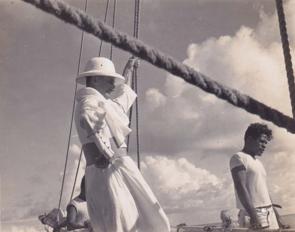 """Bishop Vincent Kennally standing at the mast of """"Star of the Sea"""" en route to the Mortlock Islands."""