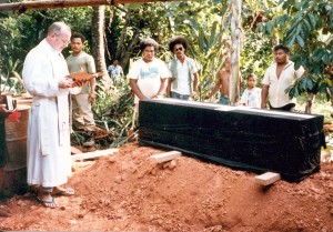 Father Horgan saying prayers at a Yapese funeral.