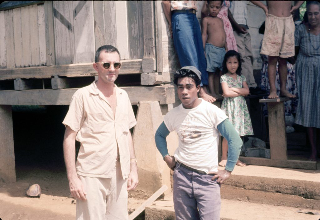Father Bill McGarry, SJ, with a local family in local Pohnpei family, circa 1960